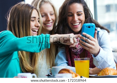 A group of friends having fun with smartphones - stock photo
