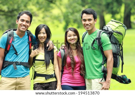 A group of friends on a hiking / camping trip together - stock photo