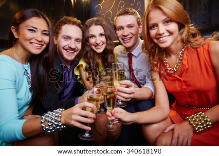 A group of friends toasting with glasses of champagne - stock photo