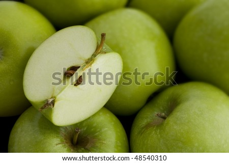 A group of Green Apples with a Cut Quarter - stock photo