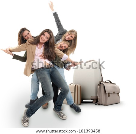 A group of happy girls celebrating a holiday travel - stock photo