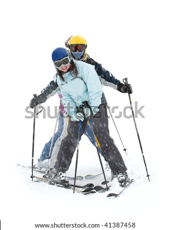 A group of happy skiers in heavy snowfall