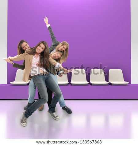 A group of happy women having fun indoors with lots of copy space - stock photo