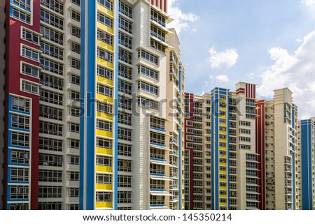 A group of high rise colorful residential apartments. - stock photo