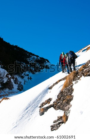 A group of hikers in Bucegi mountains, in winter season