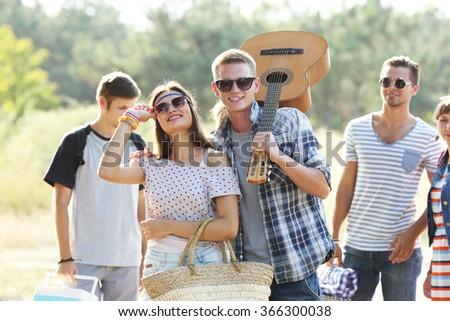 A group of joyful friends having fun outdoors - stock photo