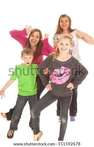 a group of kids having fun and doing silly poses. - stock photo