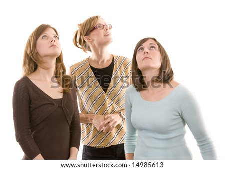 A group of ladies looking up. - stock photo