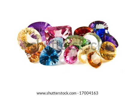 a group of large faceted gemstones on a white background