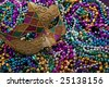 A group of Mardi Gras beads an mask with copy space - stock photo