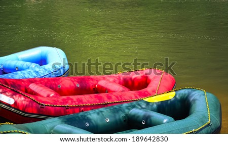 A group of men and women white water rafting - stock photo