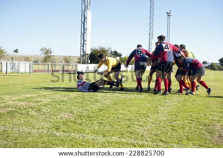 A group of men playing rugby - stock photo
