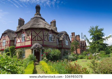 A group of mid 19th century cottages, surround the village green at Somerleyton, Suffolk, England. - stock photo