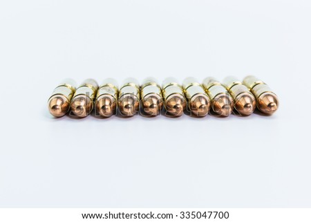 A group of 9mm bullets for a a gun isolated on a white backgroun - stock photo