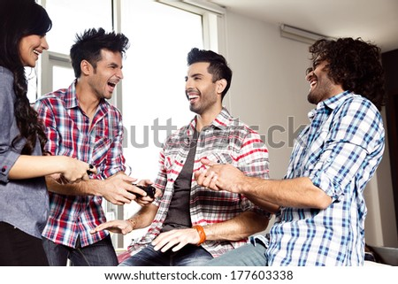 a group of  multiracial friends hanging out and having fun - stock photo