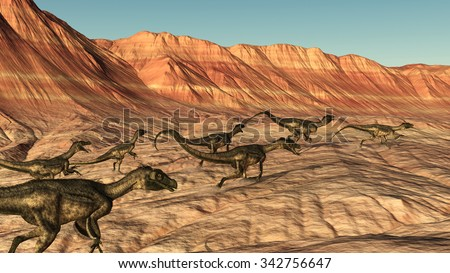 A group of Ornitholestes dinosaurs roam across a rocky desert landscape - 3D render.
