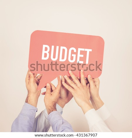 A group of people holding the Budget written speech bubble