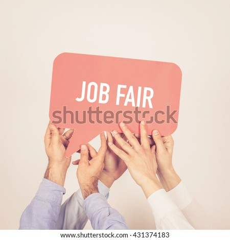 A group of people holding the Job Fair written speech bubble
