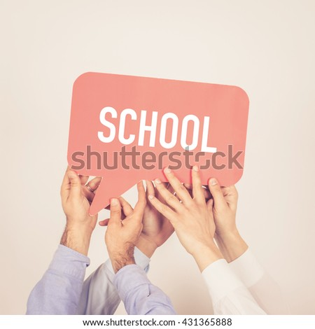 A group of people holding the School written speech bubble - stock photo