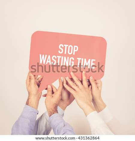 A group of people holding the Stop Wasting Time written speech bubble - stock photo