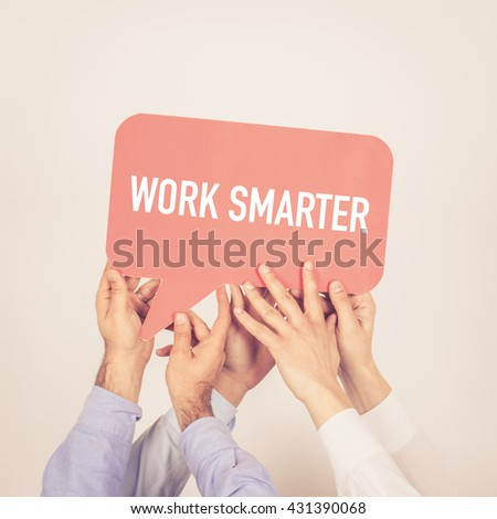 A group of people holding the Work Smarter written speech bubble - stock photo