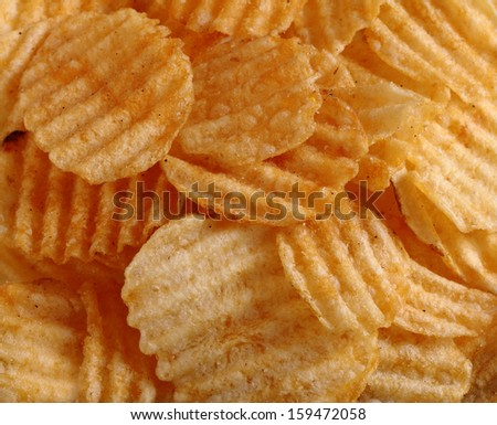 A group of potato chips snack on dark wooden background