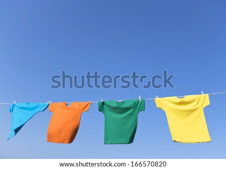 A group of primary colored t-shirts  - stock photo