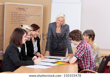 A group of professional people having a meeting in conference room - stock photo