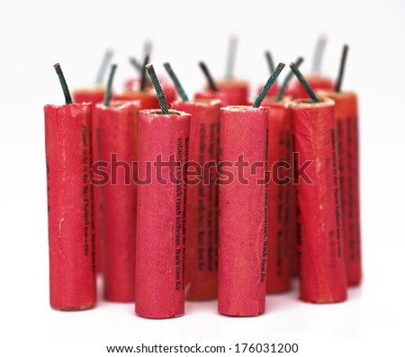 A group of red firecrackers on a white background. - stock photo