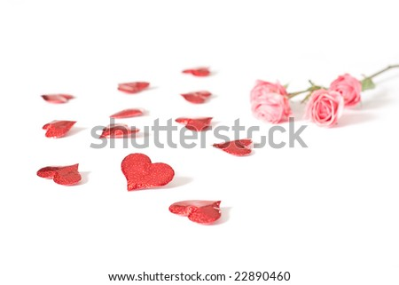 A group of red hearts and a pink rose isolated on a white background.