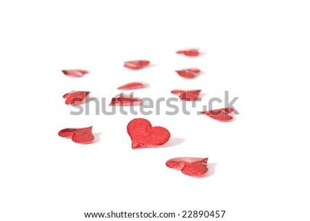 A group of red hearts isolated on a white background.