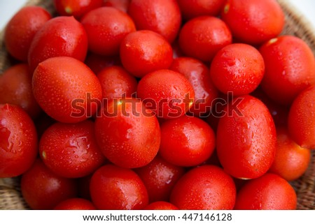 A group of red, juicy and fresh plum tomatoes, horizontal