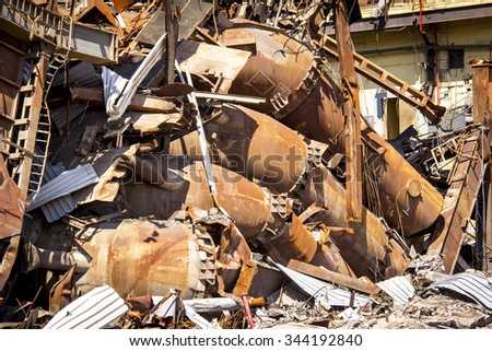 A group of rusty pipes, mufflers, and exhaust systems. - stock photo