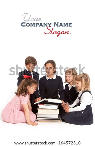 A group of school kids with an older girl explaining something  - stock photo