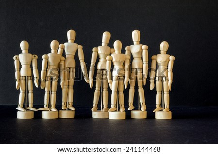 A group of seven artist manikins - stock photo