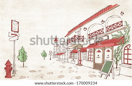 A group of small stores along a cobblestone street. - stock photo