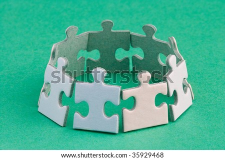 A group of small upright jigsaw puzzle pieces