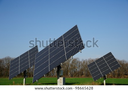 A group of solar panels in the green