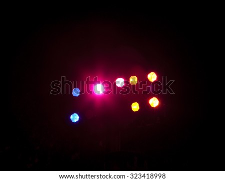A group of spotlights illuminating a stage with a bit of lighting flare. - stock photo