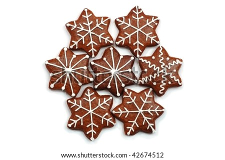A group of 7 star shaped Christmas decorated sweets (ginger bread) painted with white. Isolated on white - stock photo