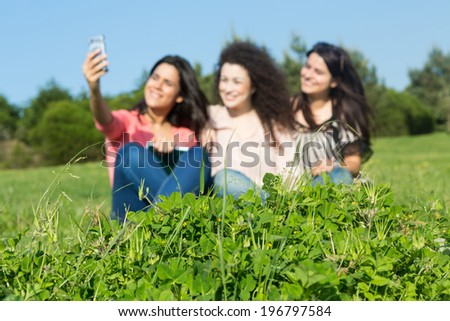 A group of students relaxing at the park - Selective focus on the grass