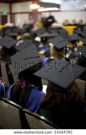 A group of students seated at graduation.