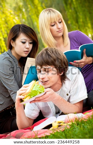 A group of teenage students. Outdoors shoot - stock photo