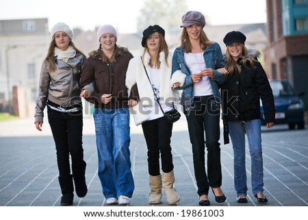 A group of teenage walking towards the camera