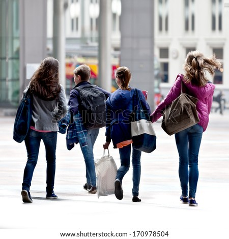 A group of teenagers on the street. Urban scene.