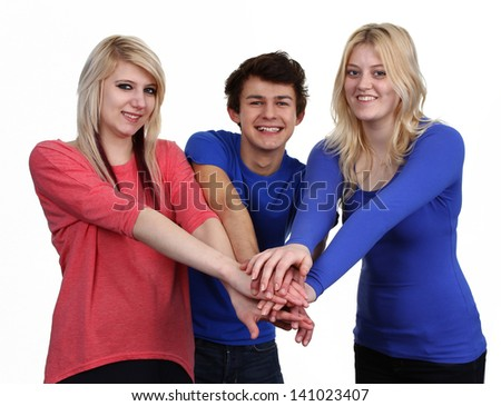 A group of three friends holding hands together, isolated on white.