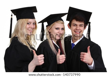 A group of three graduates, with a thumbs up sign, isolated on white