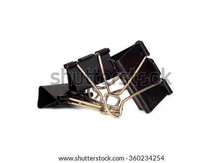 a group of three paper clips isolated on black background