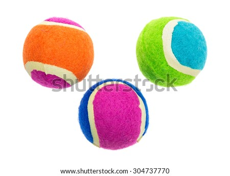 A group of three small rubber fetch balls for dogs on a white background. - stock photo
