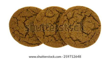 A group of three soft delicious molasses cookies on a white background. - stock photo